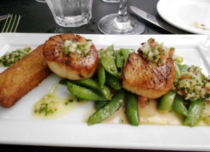 Seared scallops, lavender oatmeal panisse, sugar snap peas, honeydew melon & mustard seed vinaigrette