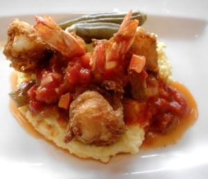 SweetGrass shrimp & grits w/hush puppy, pickled okra, Creole sauce