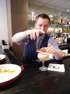 Jamie Dodge, Beverage Manager at Barrio Costero puts a finishing touch on his Hotel Nacional cocktail